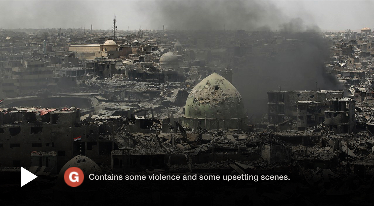 A BBC News trigger warning example describing graphic violence and upsetting scenes overlaid on a non-autoplay video about Islamic State's violence in Mosul, Iraq